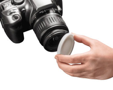Image_Gallery_Rigur_PJ_hand_holding_cap_on_camera_white2